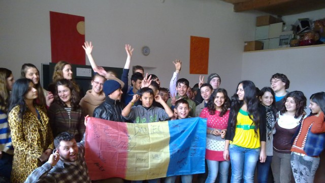 Veritas kids with flag of Romania
